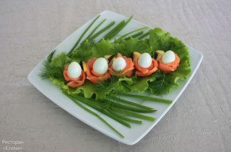 Quail eggs wapped up in salmon