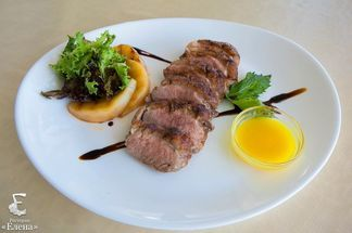Duck fillet with orange sauce.