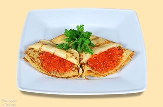 Pancakes with salmon eggs
